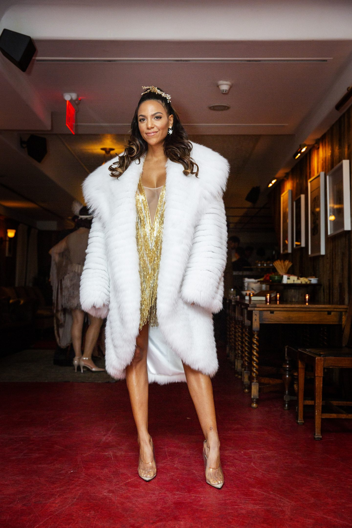 Britney Wilson wears a custom white fox fur coat