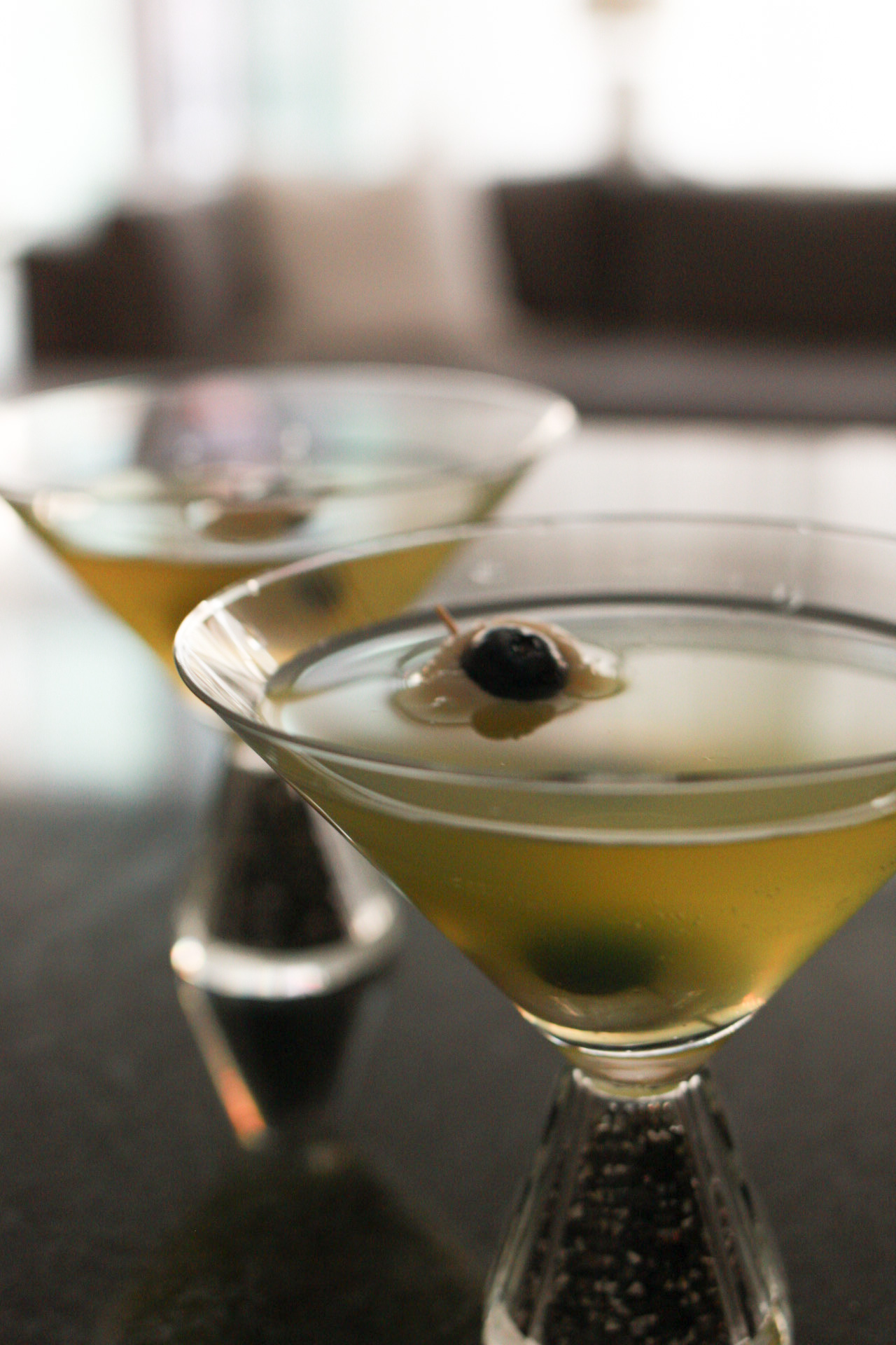 sour apple martini with lychee garnish