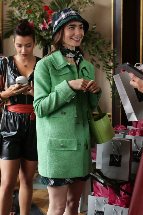 Lily Collins in green chanel coat