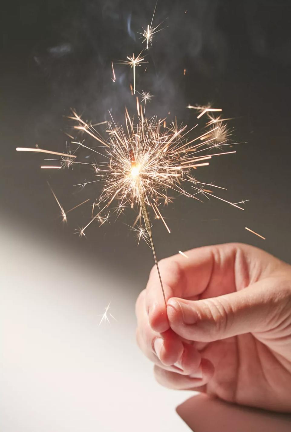 hand holding mini sparkler