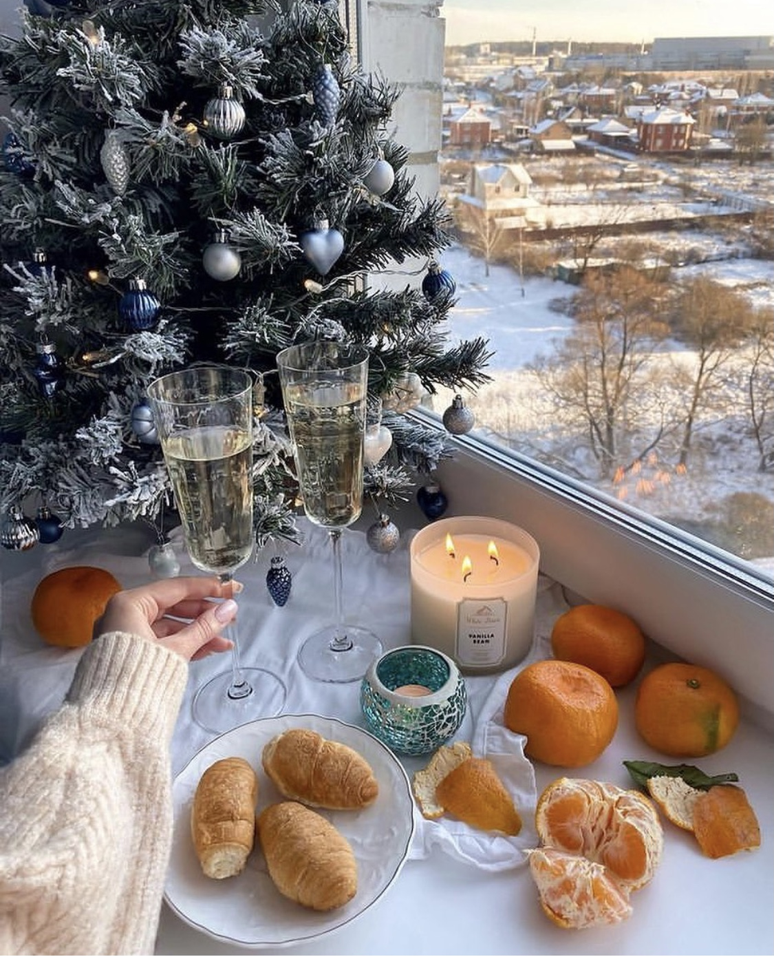 champagne flutes with Christmas tree in background
