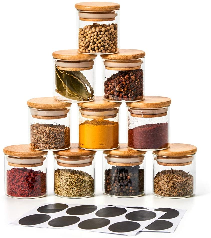 stack of glass containers filled with spices