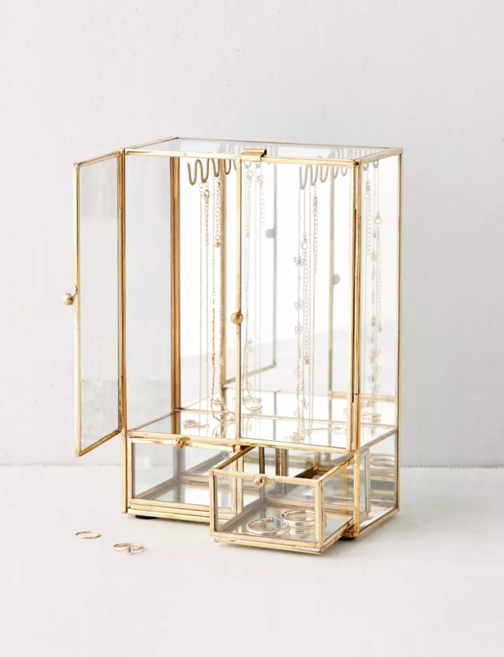 tall two door glass jewelry box with gold detailing