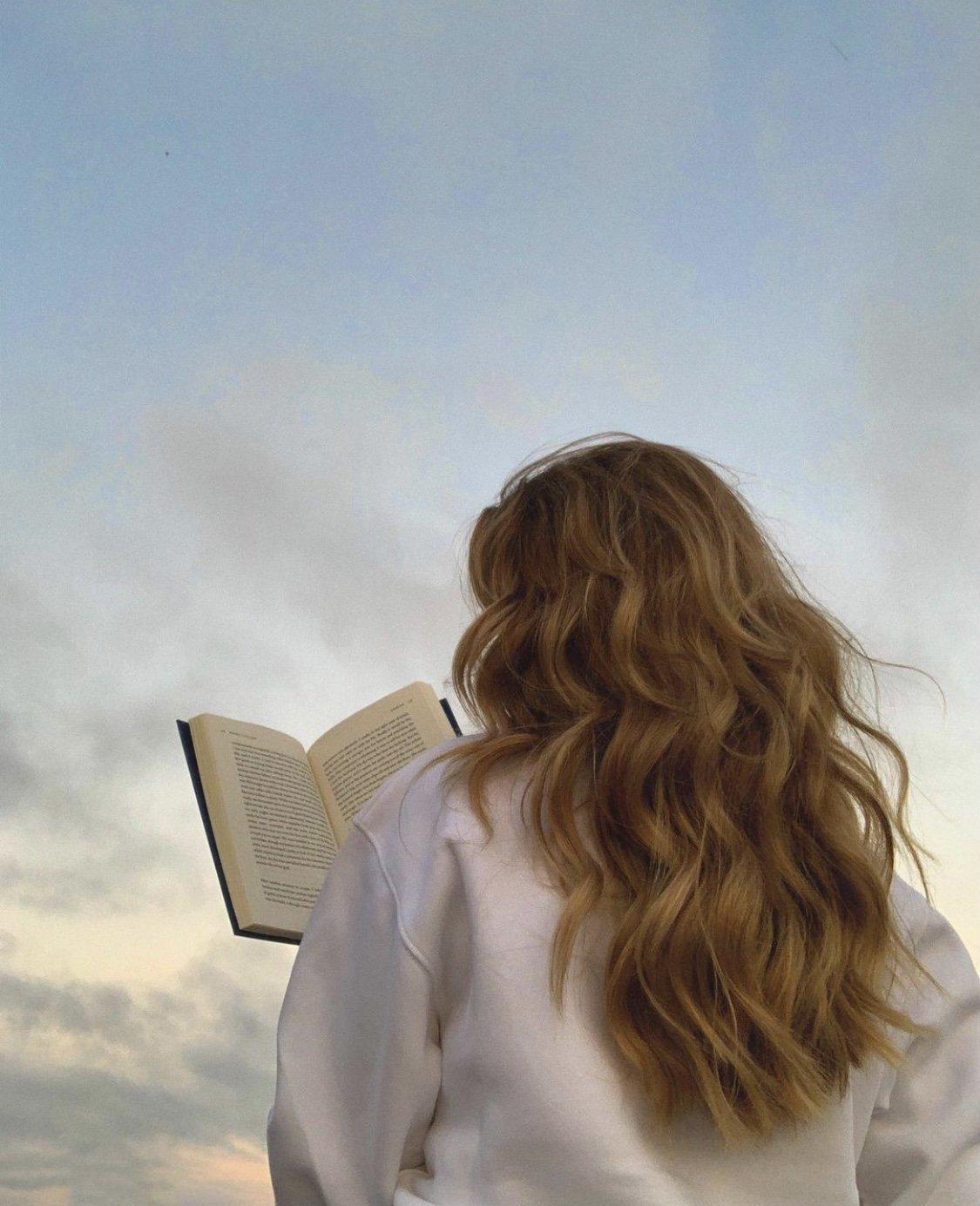 blonde girl reading outside