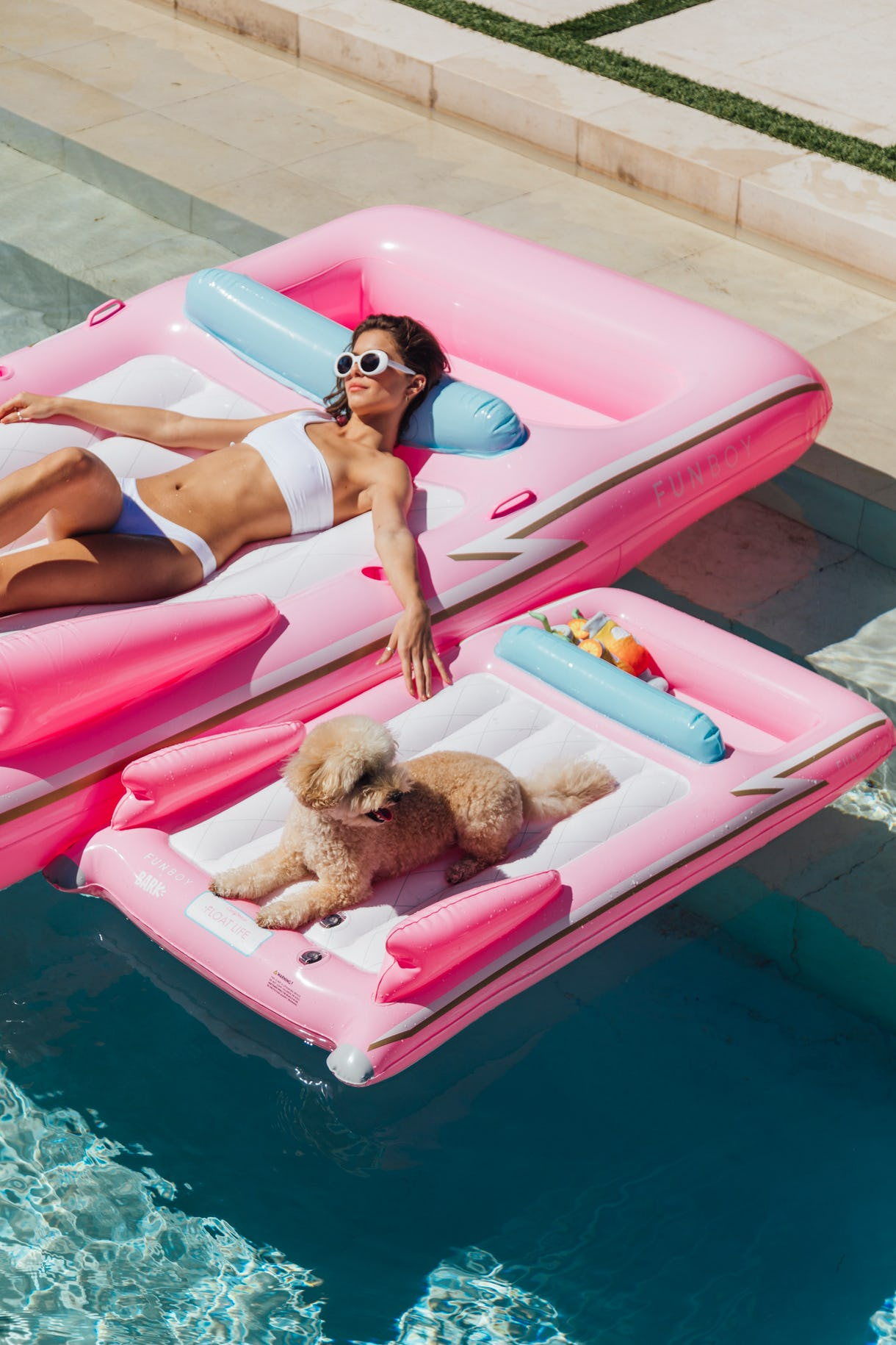 woman in pool float with matching dog float