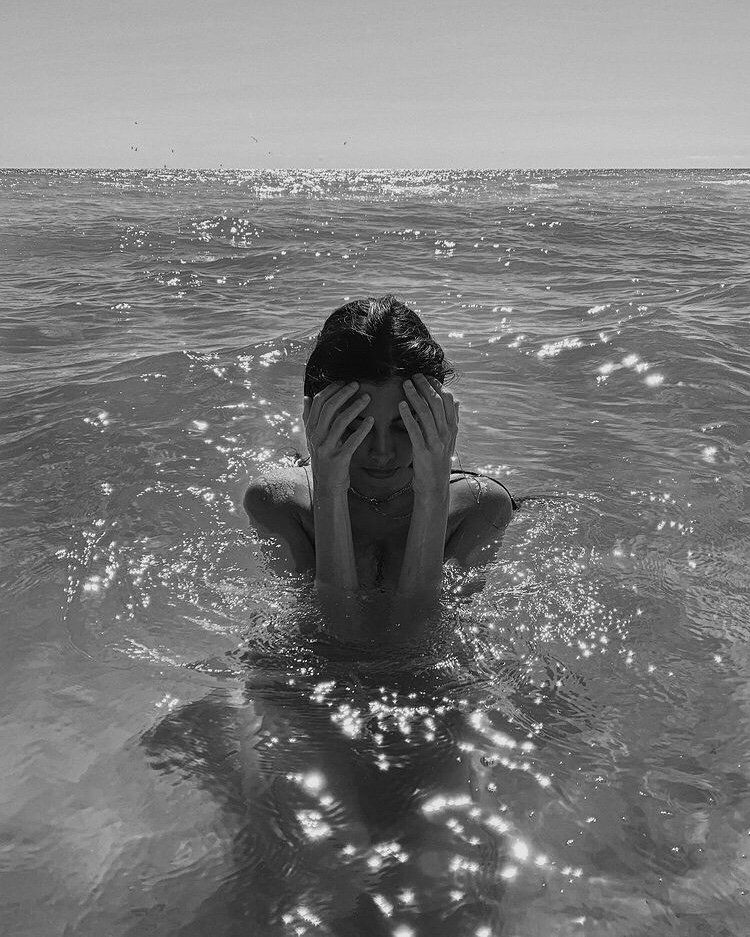 black and white image of woman in ocean