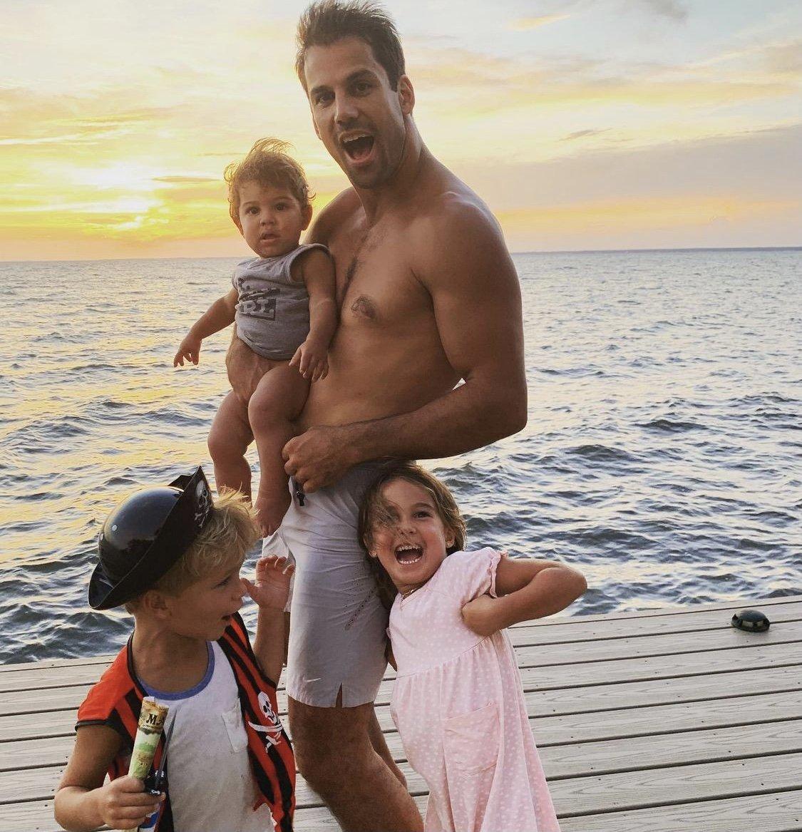 Eric decker with his children on pier